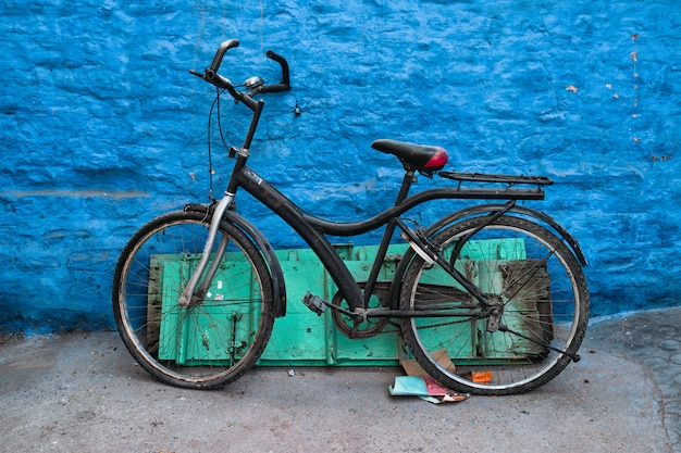 Bicycle by blue house in streets of of jodhpur