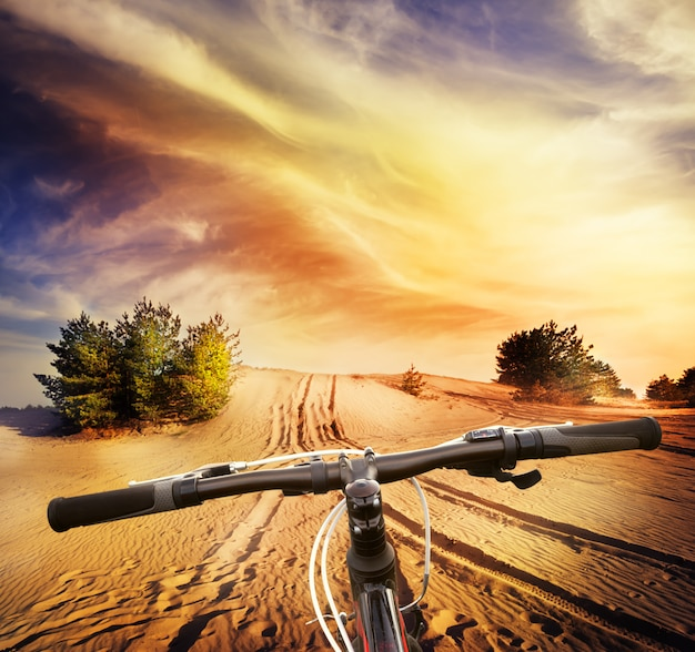 Bicycle handlebar on the desert sand