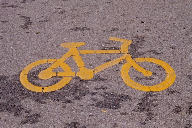 Bicycle lane sign on the road.
