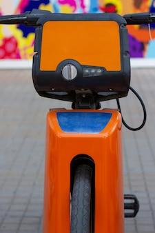 Bicycle on orange parking lot in urban city bike rental eco friendly transportation concept