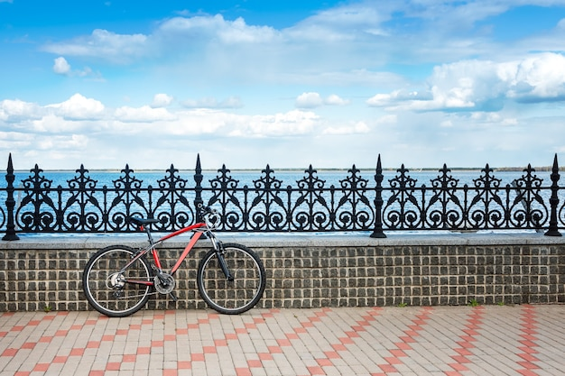 Bicycle parked on the bank of the river