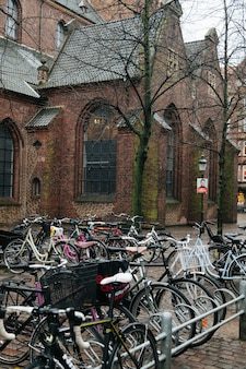 Bicycle parking against old church