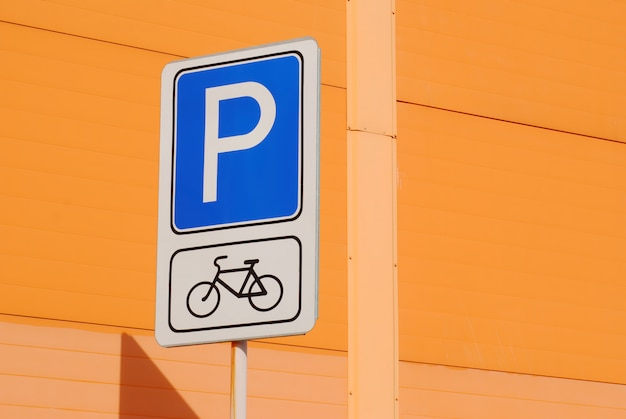 Bicycle parking road sign isolated on orange