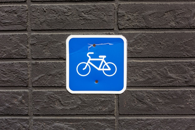 Bicycle parking sign on stone wall