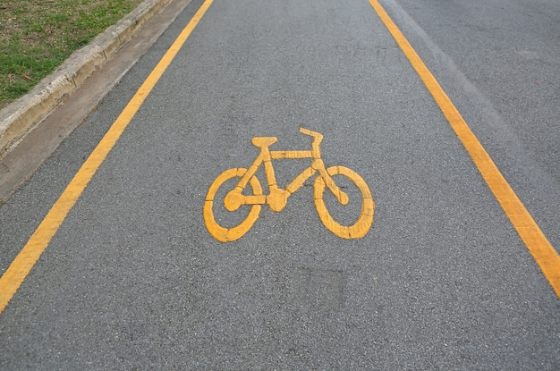 Bicycle sign on surface of street
