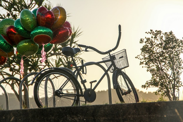 Bicycle trapped in a bike rack at the dawn of rio de janeiro.