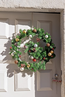 Bicycle wheel decorated as christmas wreath. xmas upcycling handcraft design concept