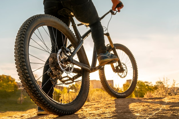 Bicycle wheels close up image on sunset