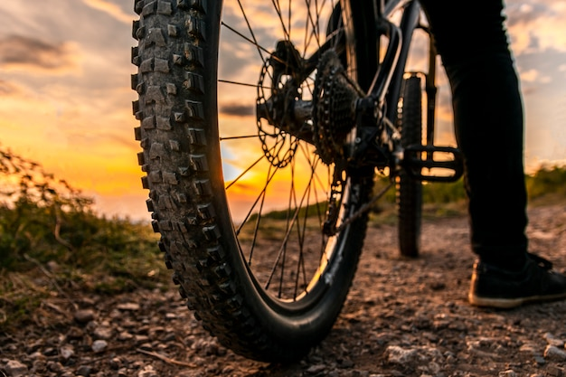 Bicycle wheels close up image on sunset