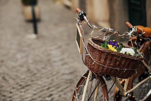 Bicycle with wicker brown basket and black table for writing.
