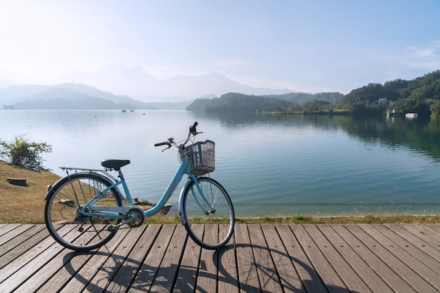 Bicycle on wooden bridge with the nice view in the morning