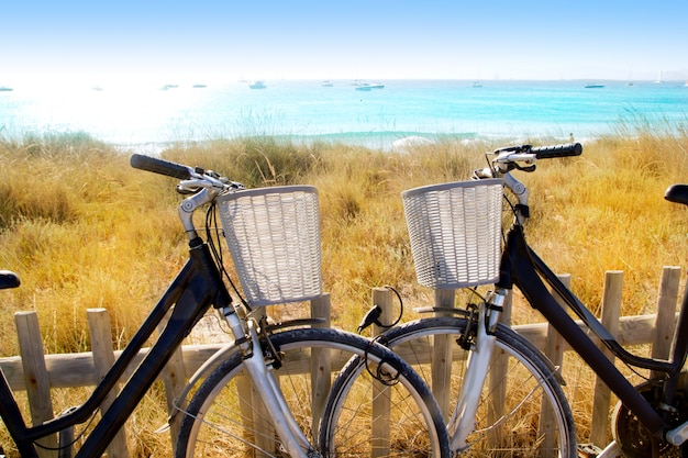 Bicycles couple parked in formentera beach