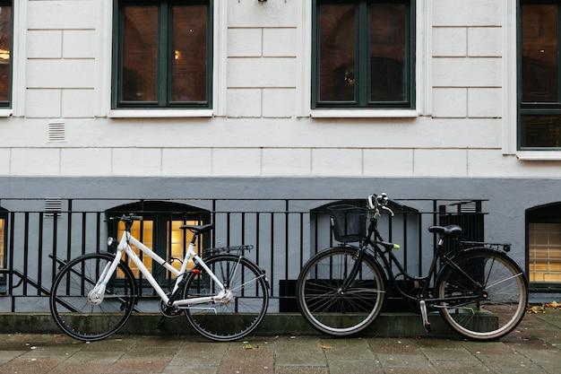 Bicycles on sidewalk against building Free Photo