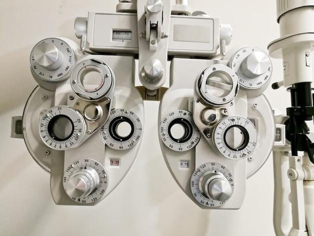 Bifocal optometry eyesight measurement device on white backgroun