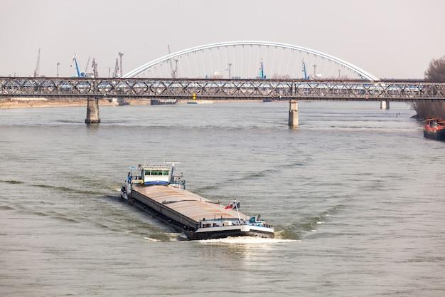 Big barge navigates danub river in bratislava