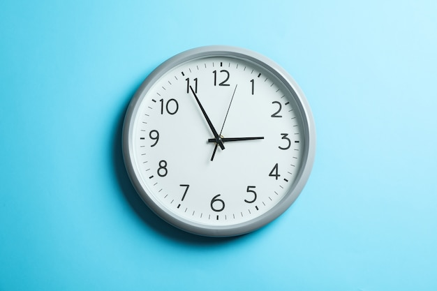 Big beautiful clock on blue, space for text