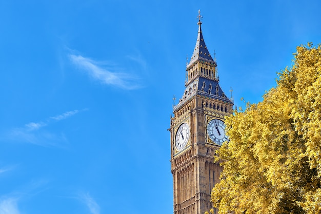 Big ben clock tower in london, uk, on a bright day in autumn