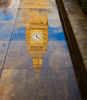 Big ben clock tower puddle reflection london