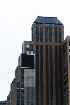 Big billboard template on building in city