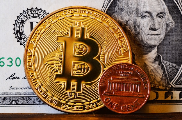 Big bitcoin and american cent against the background of the us dollar