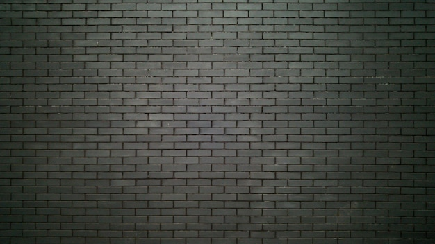 Big black wall made of bricks. black bricks texture