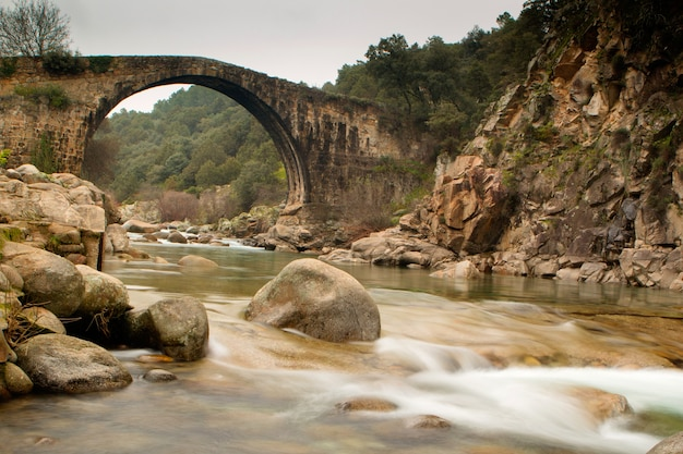 Big bridge with waterfall in extremadura