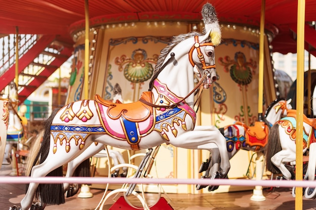 Big carousel with horses at a fair