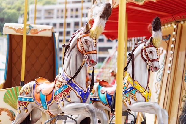 Big carousel with horses at a fair