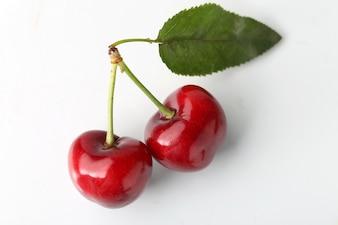 Big cherry on white background