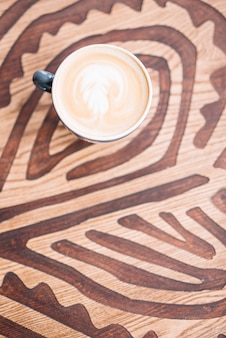 Big coffee cup on wooden table