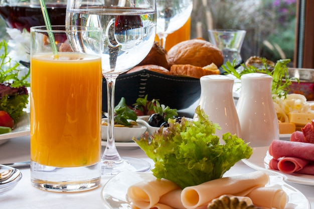 Big cold breakfast with orange juice