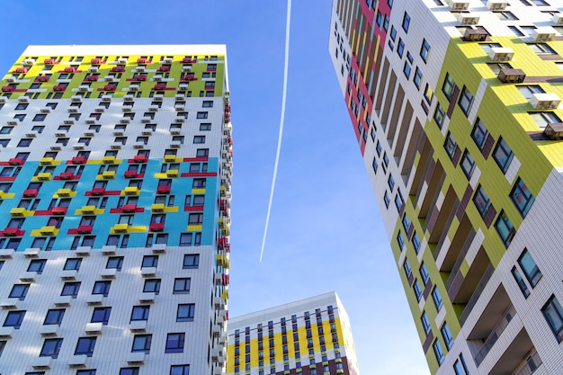 Big colorful apartment buildings in residential settlement