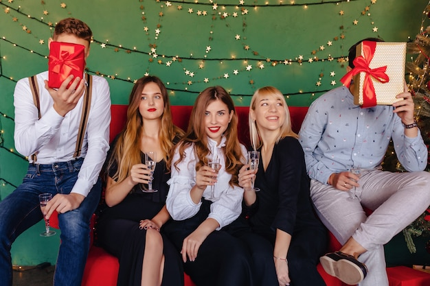 Big company celebrates a new year with glasses of champagne