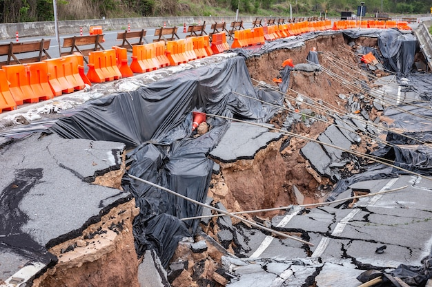 Big damage of asphalt road on the hillside cause of heavy rain and sliding earth