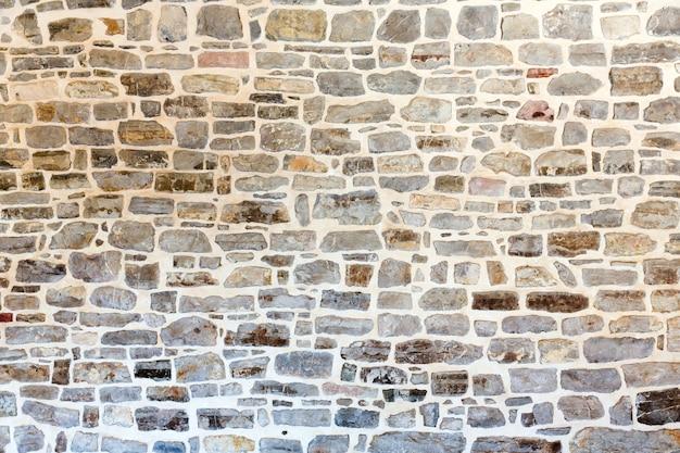 大きな暗い石の壁の背景