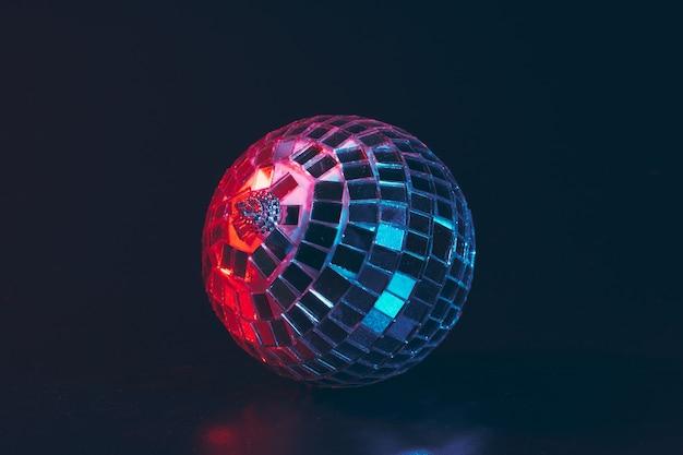 Big disco ball close up on dark