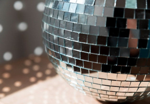 Big disco ball on floor with party lights