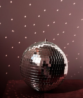 Big disco ball on brown floor with lights