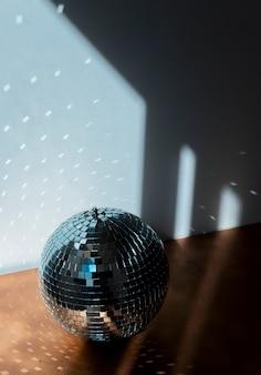 Big disco ball on brown floor