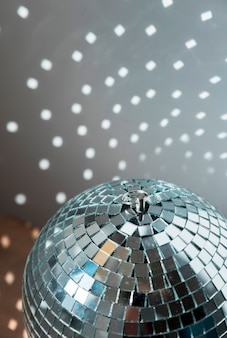 Big disco ball with bright party lights
