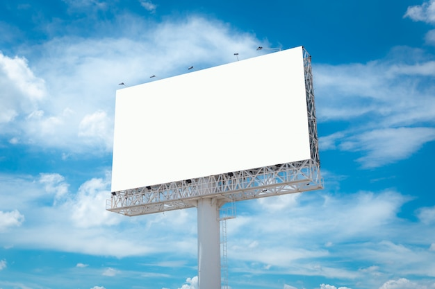 Big empty billboard with blue sky and clouds.