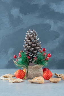 Big festive christmas pinecone with dried fruits . high quality photo