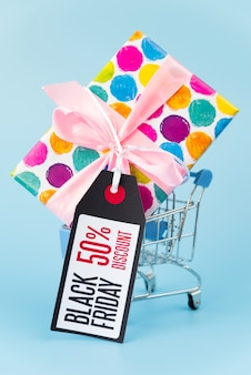 Big gift in shopping cart with tag