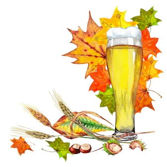 Big glass of light beer with autumn leaves