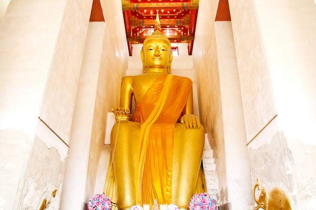 Big golden buddha statue in public wat palelaiworaviharn temple at suphanburi