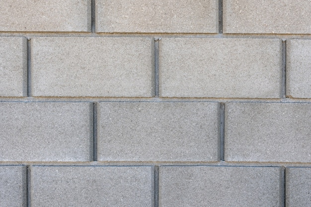 Big grey concrete brick wall texture background, material of industry construction.