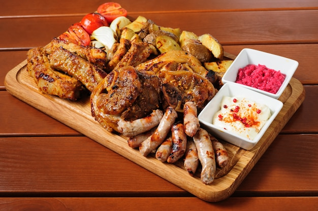Big grilled meat and vegetables board