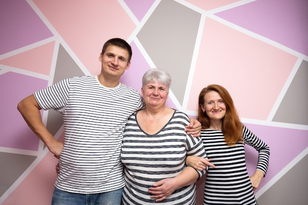 Big happy family. mother with daughter and son on a bright background