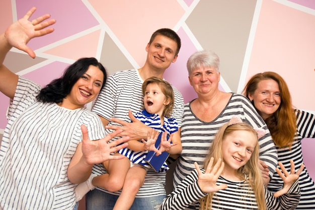 Big happy family. mother with daughter, son and granddaughters on a bright background