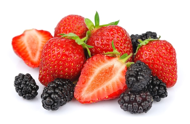 Big heap of berries of strawberry and mulberry